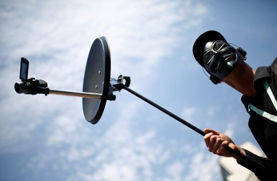 A protester holds mock bugging device during a demonstration against the National Security Agency (NSA) and in support of U.S. whistleblower Edward Snowden in Frankfurt. Protests across Germany have gained following the leaking of the NSA intelligence agency's monitoring of international internet traffic.