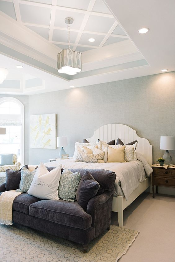 Master Bedroom. The master bedroom features white bed, tray ceiling and pillows with fabrics by Sarah Richardson. #MasterBedroom #SarahRichardson #Fabric Four Chairs Furniture.