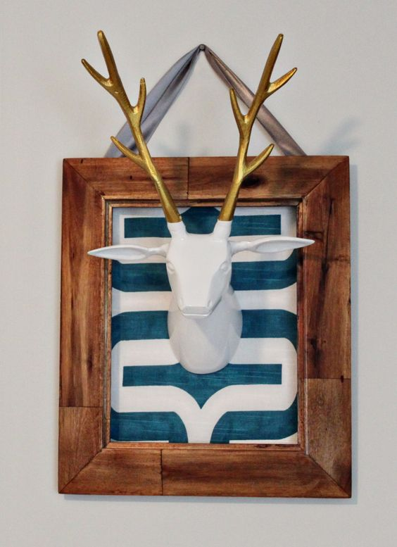Framed taxidermy in the nursery - so chic and modern! #nursery #nurserydecor: