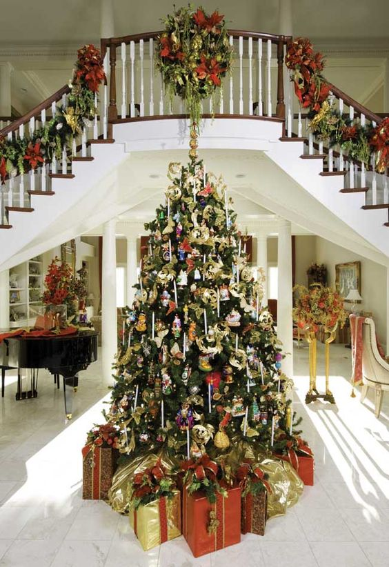 Oh To Dream Of Large Stair Cases High Ceilings Wood Banisters And A Baby Grand Piano For John T Beautiful Christmas Trees Christmas Home Christmas Staircase