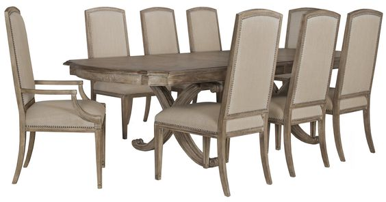 Dining set includes: Rectangular table and four upholstered chairs  The Artesano rectangular dining set invites your guests to dine in delectable style. With details like a dramatic scrolled base, detailed wood inlay, and individual nailhead trim, this light tone dining set brings everyday luxury to new levels.