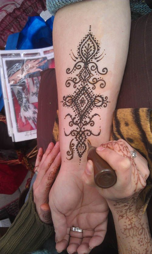 Painting Henna  My Daughter is so good at this.  Patience is Key.