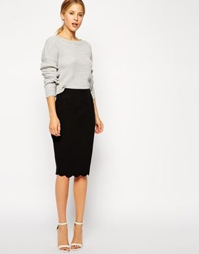 Black pencil skirt with scallop hem. Love basic items with a unique touch.