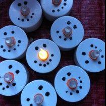 Little Snowman lights out of battery votives.