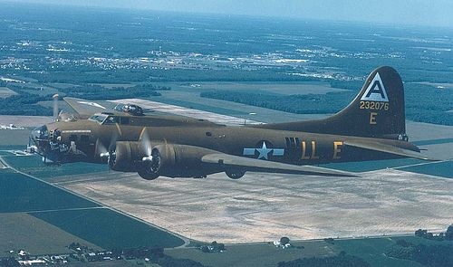 Boeing B-17G Shoo Shoo Shoo Baby en route to the National Museum of the US Air Force on 10.12.88. Armament: 13 .50-cal. machine guns;  bomb load of 6,000 lbs.  Engines: 4 Wright Cyclone R-1820s of 1,200 hp each  Maximum speed: 300 mph  Cruising speed: 170 mph  Range: 1,850 miles  Ceiling: 35,000 ft. Span: 103 ft. 10 in.  Length: 74 ft. 4 in.  Height: 19 ft. 1 in.  Weight: 55,000 lbs. loaded  Serial number: 42-32076  (U.S. Air Force photo) Posted by Charles McCain