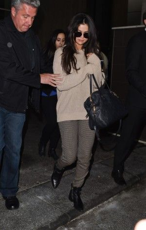Selena Gomez wearing Louis Vuitton Lumineuse GM Shoulder Bag and Zara Leather Ankle Boots with Double Zips