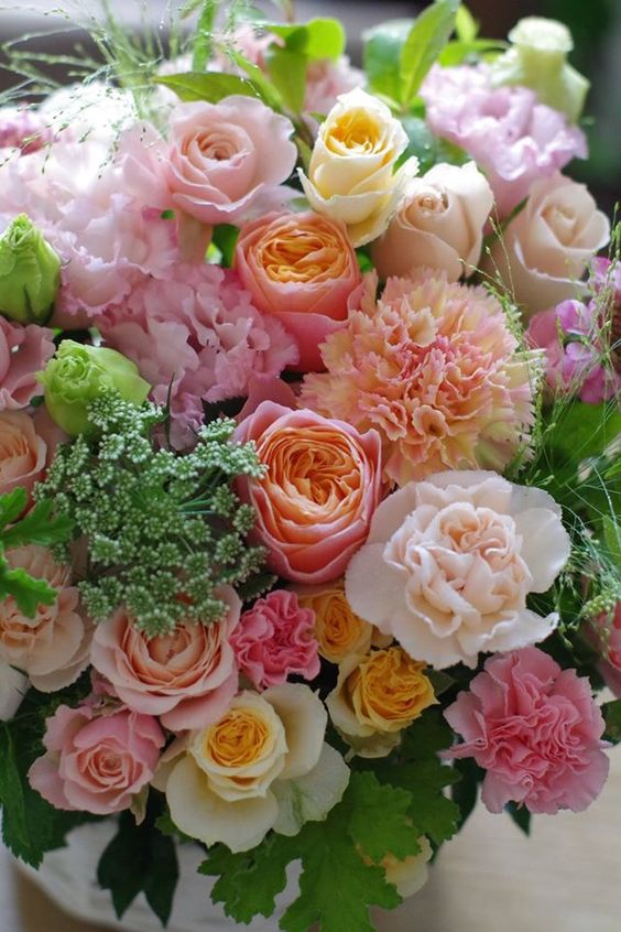 A variety of perfect roses with a kiss you delightfully fluffy peonies
