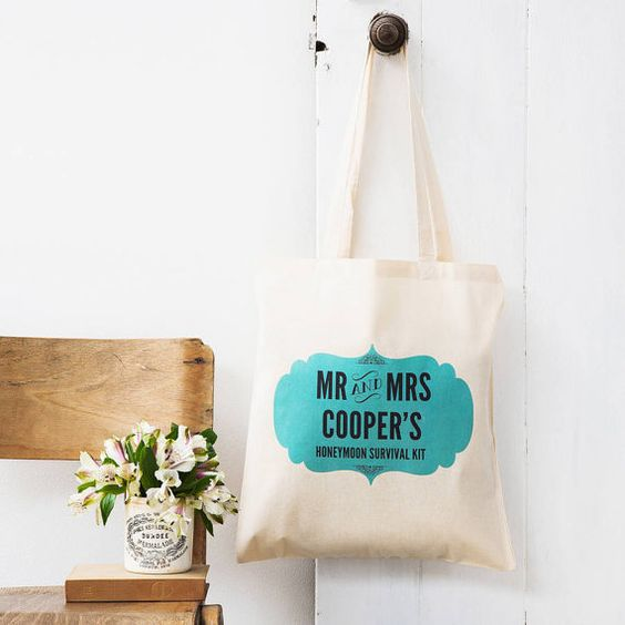 Once theyve survived the wedding, help the newlyweds on their way with these personalised honeymoon tote bags. Fill them with goodies for a survival kit!  A honeymoon survival kit is such a fun and original gift, so weve created these personalised bags to get you started. Add your own blend of eye masks, or booze, or disposable cameras - the world is your oyster, and theirs.  These bags are personalised with the couples names, and printed onto cotton.  Really fun and practical, theyll also…