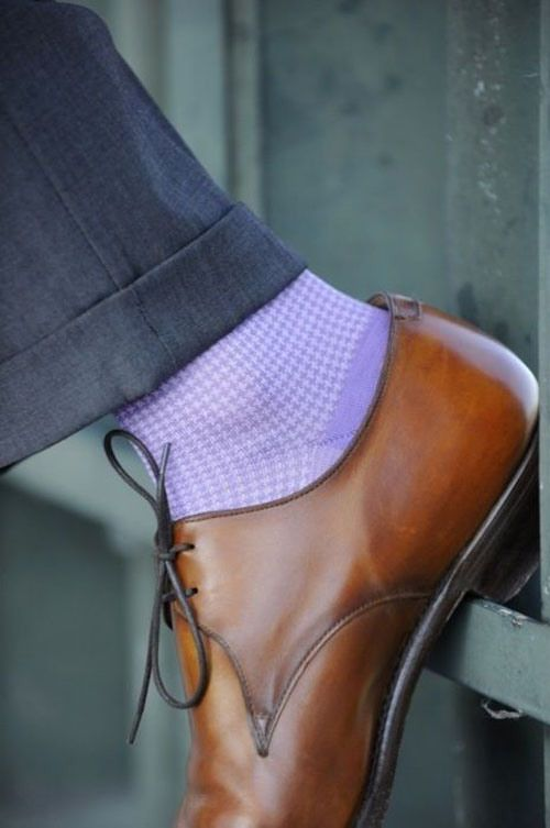 Lavender socks, charcoal suit, with brown lace-ups.:
