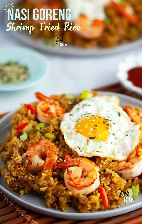 #NasiGoreng This Nasi Goreng or  Indonesian fried rice with shrimp is one of my favorite fried rice recipes that packs a punch of sweet, spicy and savory flavors your family will love.  Great use for leftover rice and ready in 15 minutes.