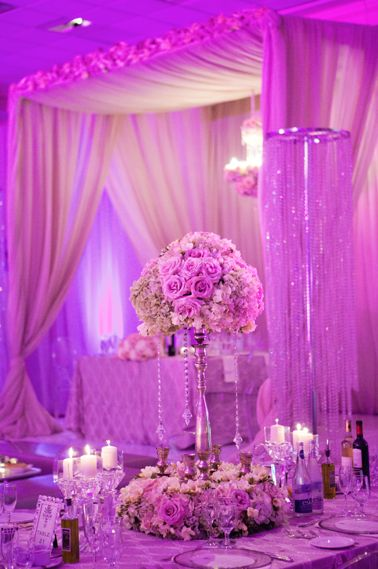 Beautiful flowers and crystal centerpieces help create a romantic and elegant look!