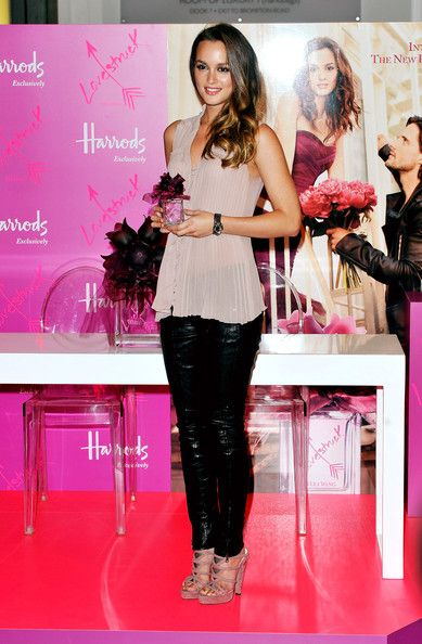 I love everything about this outfit from the leather pants to the sheer top!