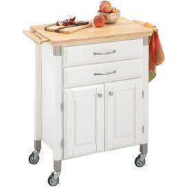 "Wooden kitchen cart with castered feet.   Product: Kitchen cartConstruction Material: Wood and metalColor: White and naturalFeatures: Ample drawer and cabinet spaceLocking casters provide mobilityClear protective lacquer Dimensions: 36"" H x 31"" W x 17.75"" DNote: Accents not included"
