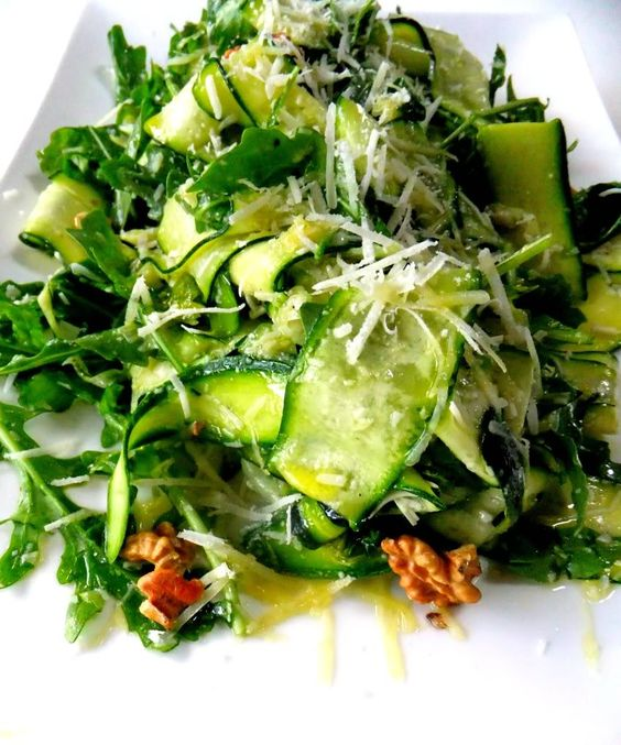 YUM!  an extremely fresh salad that you can't stop eating, try this Zucchini Carpaccio      Salad. Paper thin slices of fresh zucchini tossed with baby arugula, shredded Parmigiano Reggiano, garlic, lemon zest and olive oil. Topped with toasted walnuts.: