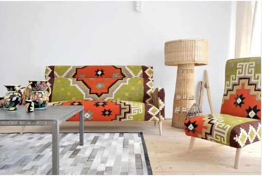 Really fun  sofa and chair upholsteredin  antique Tunisian kilim fragments...very chic in this room!