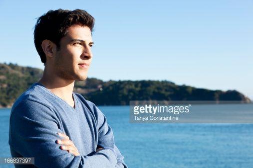Stock Photo : Mixed race man overlooking waterfront