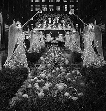 10 Dec 1954, New York, New York, USA --- Glittering angels lining the promenade at Rockefeller Center