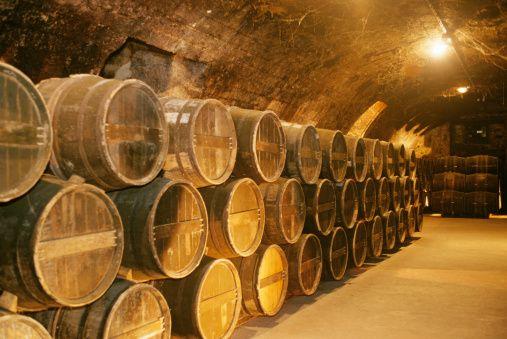 France, Cognac, Otard distillery, Rows of kegs in cellar