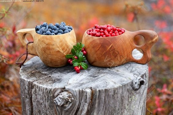 Kuksa - wooden mug from Lapland, Finland, filled with Lingonberries and Blueberries.: