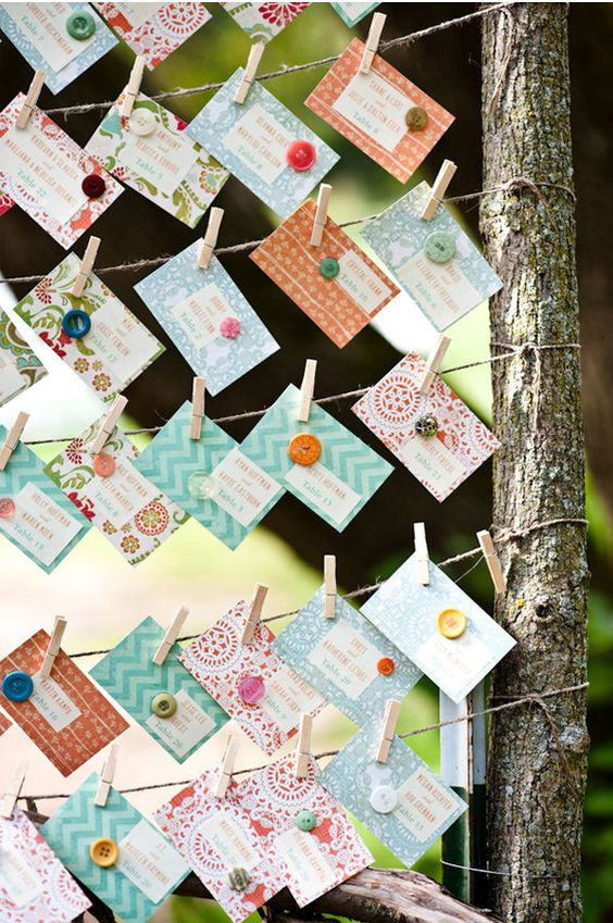 A slightly different take on an escort card tree, and what a nice design for the cards. The cards could also be triangle shape.