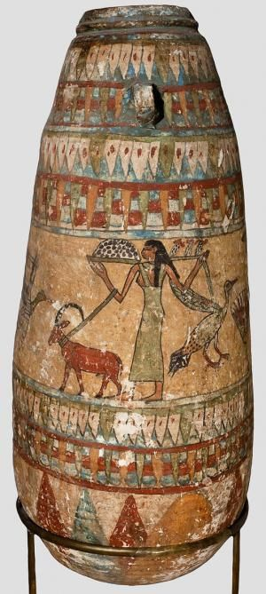 Vessel, decorated w/ ornaments of lotus petals & a central register w/ a picture of a woman leading a goat. Ancient Egypt.