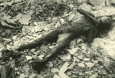 The damage of atomic bomb which Japanese Nagasaki received. Boy burned to death near ground zero. 10 august 1945.