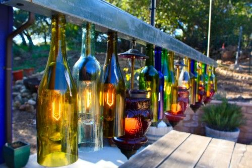 contemporary outdoor light fixture made from old wine bottles. exterior by Shannon Malone