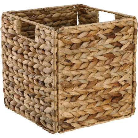 Tuck this water hyacinth basket into the craft room shelf to organize yarn and thread, or stack it with other woven containers for an eclectic country look.