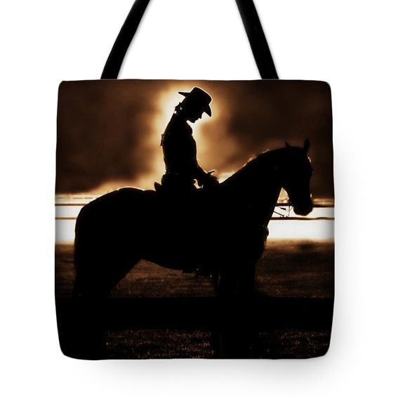 "A Cowgirls Prayer Evening Ride Tote Bag by Chastity Hoff (18"" x 18"").  The tote bag is machine washable, available in three different sizes, and includes a black strap for easy carrying on your shoulder.  All totes are available for worldwide shipping and include a money-back guarantee."