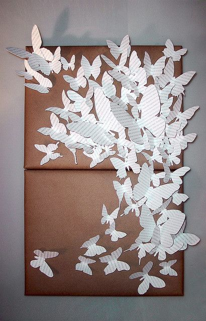cut paper and kraft-wrapped canvases: