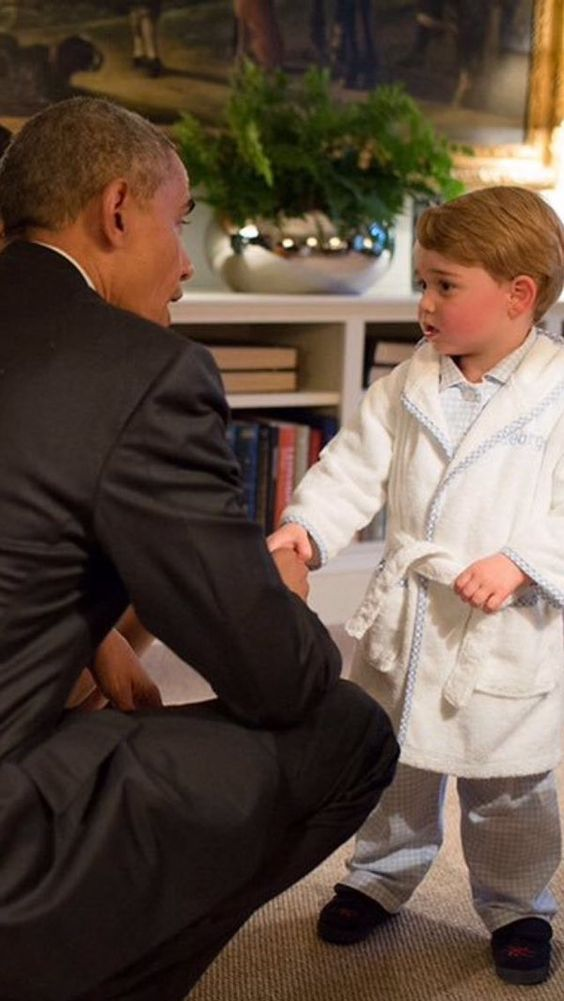 Prince George meeting President Obama in his little PJ's and slippers. April 22, 2016, Kensington Palace.