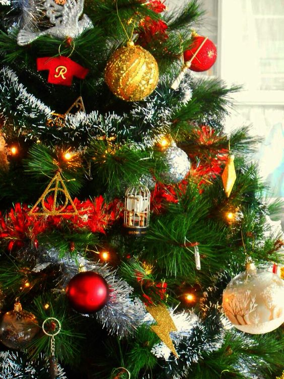 A bright and beautiful Harry Potter Christmas tree in reds and golds