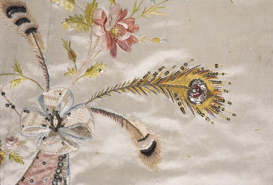This scrap of fabric was embroidered by one of Rose  Bertin's embroiderers for Marie Antoinette.  Notice  the lovely pink flower.