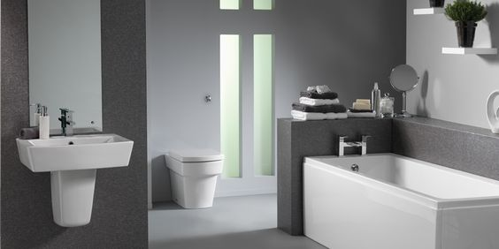 Kube Bathroom Suite    Effortless style and strong bold lines give our Kube bathroom suite the 'wow factor'. Optional matching furniture and two different basin styles make this a highly versatile range that consistently proves a popular choice. Try pairing the wall-mounted basin with a back-to-wall toilet for a stunning minimalist look without breaking the bank. The Kube suite comes as standard with a 25 year guarantee.