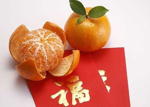 Round Fruits Particularly Mandarin Oranges Symbolize Luck For Chinese New Yea Chinese New Year Traditions Chinese New Year Party Chinese New Year Decorations