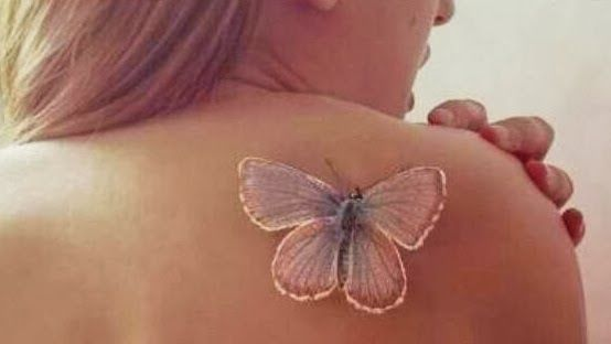 Pretty butterfly White Ink Tattoo with exquisitely soft pastels for Girls.-