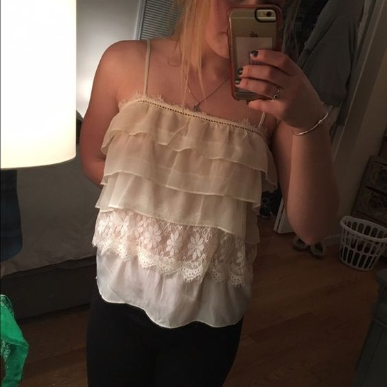 Layered tank It's super light and the layers are cute and fun. Never wore it. Wish I had but it just never fit me right. It's American eagle and bought for about $35 American Eagle Outfitters Tops Tank Tops