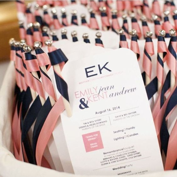 Harmony Creative wedding programs: These pink and navy programs  also serve double-duty with their attached ribbon wands for guests to wave during the couple's ceremony recessional.