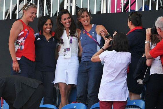 LONDON, ENGLAND - AUGUST 10:  Catherine, Duchess of Cambridge poses with British team members after the Women's Hockey bronze medal match between New Zealand and Great Britain on Day 14 of the London 2012 Olympic Games at Riverbank Arena Hockey Centre on August 10, 2012 in London, England.