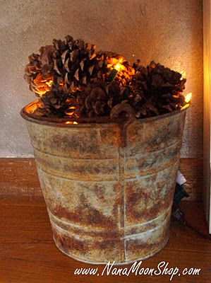 No way! I did this last Christmas by our fireplace! I got the extra small lights, connected to a battery switch so there was no visible cord. The bucket I have is a beat up old wood bucket from World Market. Pine cones are easy to find around fall, got mine at Frys, cinnamon scented!: