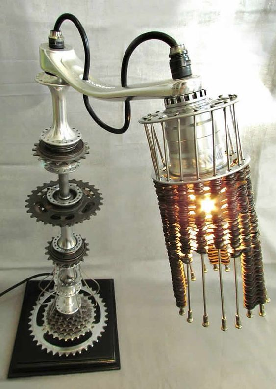 Bicycle parts table lamp collection by Velolumiere - For more great pics, follow www.bikeengines.com: