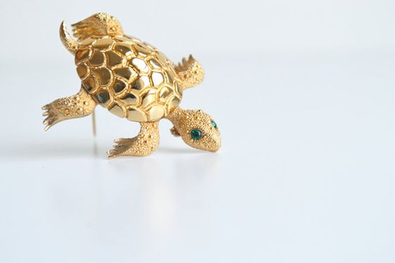 Turtle brooch, Monet, vintage    Very pretty vintage brooch, turtle-shaped, gilt-metal, textured, green beaded eyes, marked Monet to bottom,