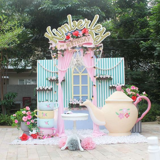 Wow!! What a fabulous Tea Party backdrop for this Garden party! Just look at that teapot!! See more party ideas at CatchMyParty.com
