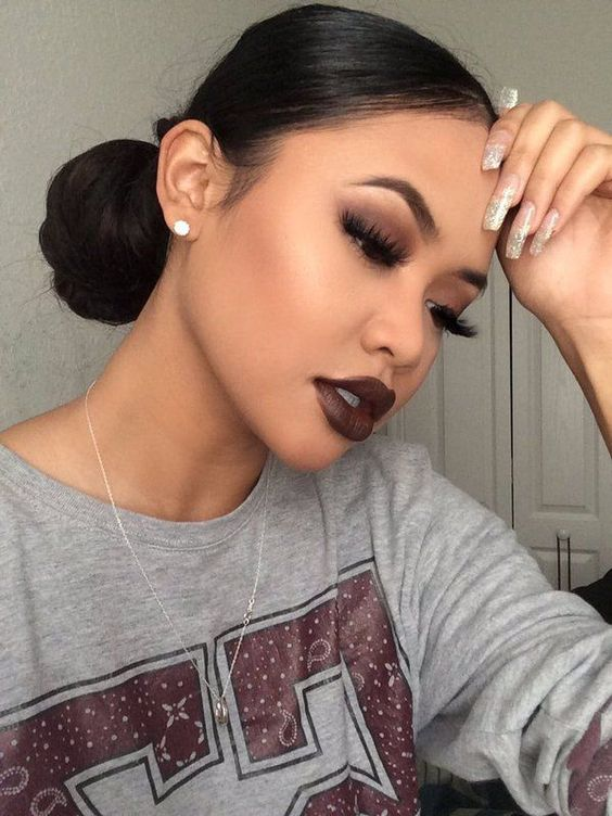 "Sleek buns and dark lipsticks  (@thewillacollection ""Wicked"" matte lipstick/ /divinelashco/ ""Cosmic"" mink lashes):"