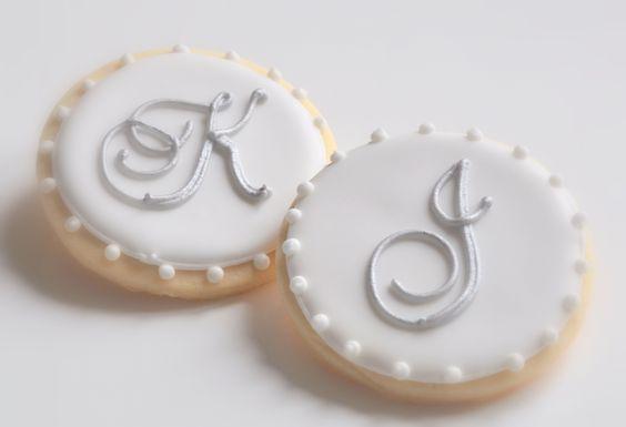 Elegant silver painted monogrammed wedding cookies.