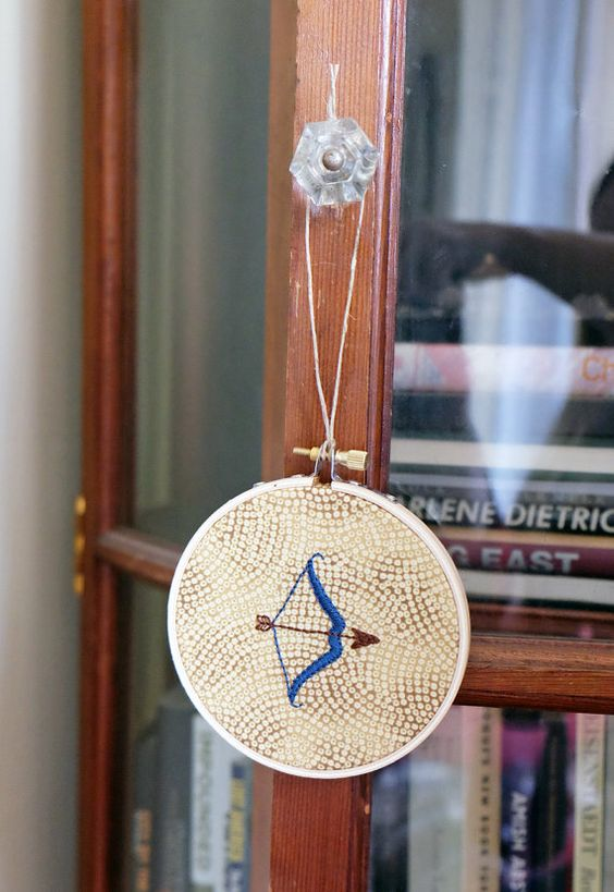 Bow and arrow hand-embroidered wall hanging by StewartFiberArts