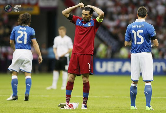 Italy's goalkeeper Gianluigi Buffon adjusts his hair during their Euro 2012 semi-final soccer match against Germany in Warsaw. PASCAL LAUENER/REUTERS