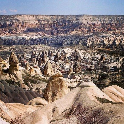 Must see place in Turkey  Cappadocia is one of the most fascinating places to visit in the world.  Some of 36 underground cities once housed upward of 20,000 people.  Unique rock formations can be seen across the planes for great picture opportunities.  See more at wanderingtrader.com  #asia #europe #turkey #cappadocia #fascinatingplace #mustsee #rockformations