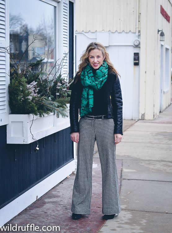 Houndstooth pants, a cozy scarf, and a bomber jacket.