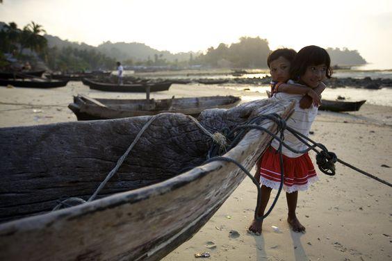 A Moken girl carrying her brother in Myanmar's Mergui Archipelago.